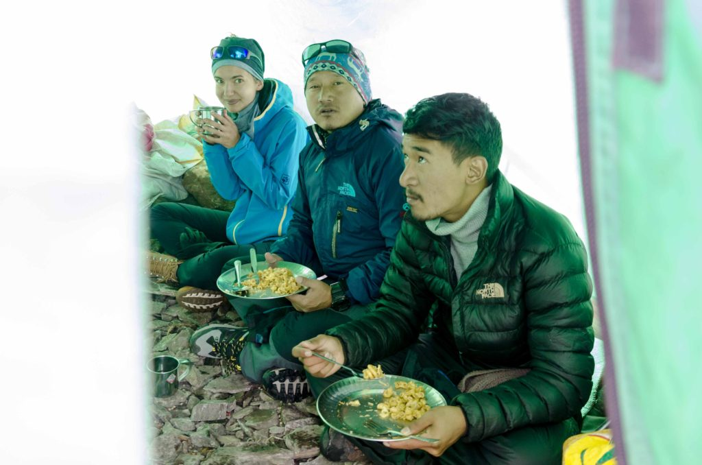 Enjoying the hospitality of the Manaslu base camp. Czech climbers let us in and provided us with macaroni and black tea. God bless boys!