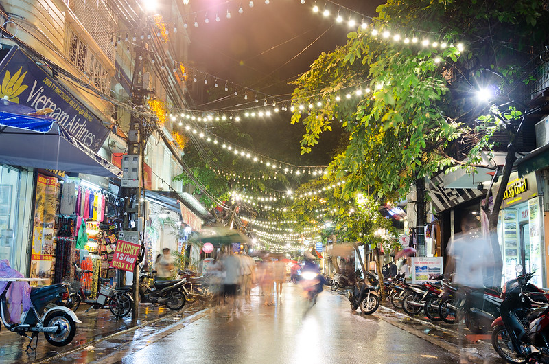 Lively narrow streets of Hanoi where the best Pho soups are served on small plastic chairs right on the street.